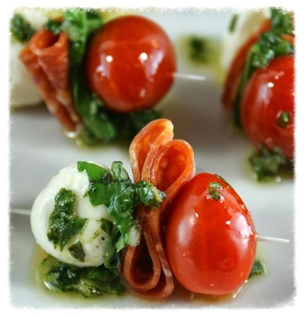 Pepperoni Caprese Bites With a Basil Vinaigrette.. Go to cookiescrumbsandchickens.blogspot.com for recipe