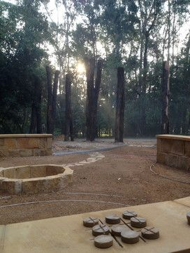 Contemporary Australian Native Garden with sandstone seating, firepit and noughts and crosses game by Clint Kenny Design  www.clintkenny.com.au