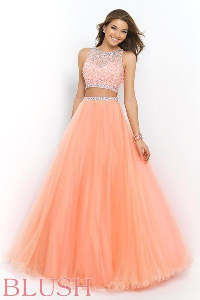 <p>Rock the latest fashion trend in this sassy two piece ball gown. Sleeveless top is adorned with sequins and AB crystals while the full tulle skirt features a matching beaded waist. Side zipper closure. Available in Brilliant Blue, Coral Pink, and Sand</p><p class='disclaimer'><i>The waistline on this skirt is running at least 1 inch smaller than our size chart measurements. Please take this in to consideration when ordering.</i></p>