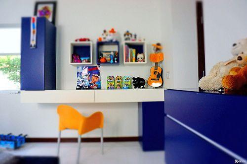glottman products | dominic crinson iko wall paper, lago morgana night stand, bonaldo square bed and segis chair orange