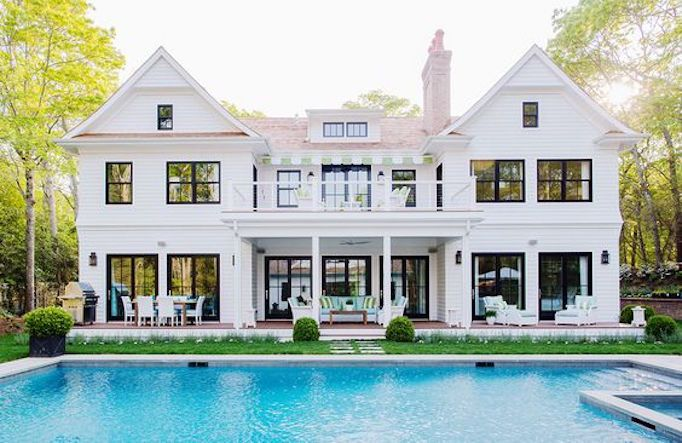 white brick exterior with pool