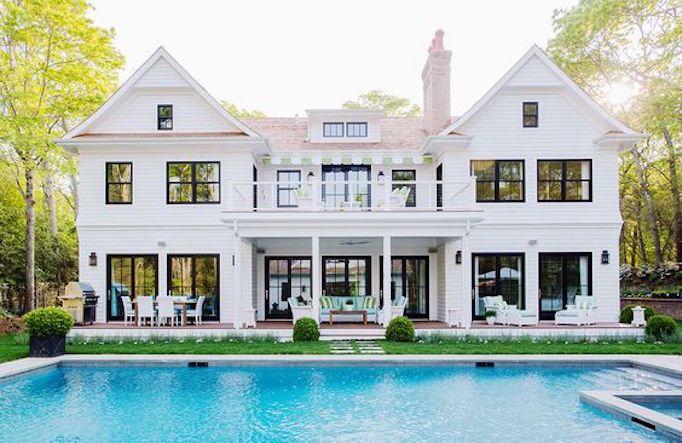 white brick exterior with pool
