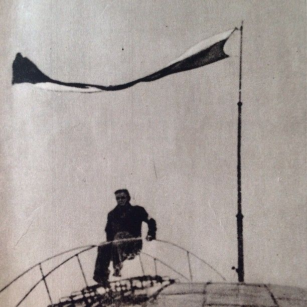 First days of August 1944, Warsaw, Polish flag on the top of the dome of bank PKO building on Świętokrzyska Street.  From Dni Powstania
