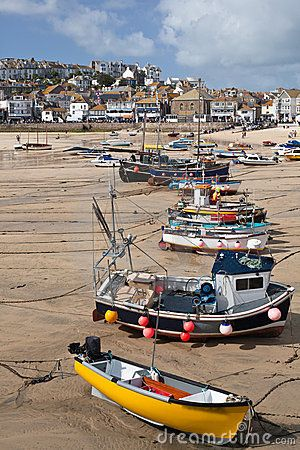 St Ives harbour at low tide in Cornwall with fishing and leisure boats sat on the sand