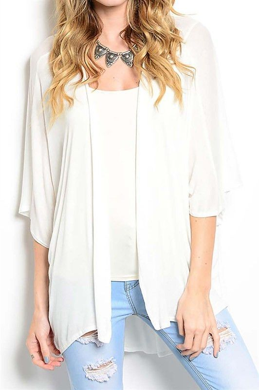 "Our White Draped Short Sleeve Cardigan is 97% RAYON 3% SPANDEX. Description: L: 30"" B: 28"" W: 27"""
