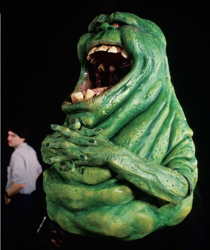 Pin for Later: You'll Never Watch Ghostbusters the Same Way After Seeing These Rare Pictures  A team of operators gave Slimer a hefty amount of personality. Steve Johnson can be seen in the background.