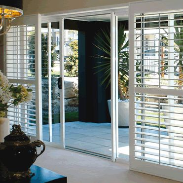 Plantation Shutters For Sliding Glass Doors With Floor And Black Table