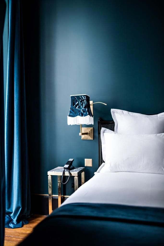 Dark blue bedroom with house of hackney lamp shade