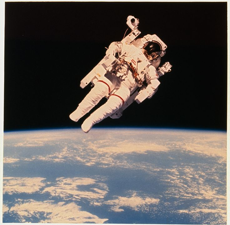 Astronaut Bruce McCandless II floats a few meters away from Space Shuttle Challenger during the historic first use of a nitrogen-propelled manned maneuvering unit in 1984.Photograph by NASA