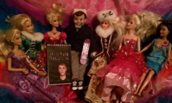 Elf on the Shelf Disguised as Justin Beiber  This elf decided to dress up as Justin Bieber to see if he's get any attention. Sure enough, all the Barbies in the house swarmed to make a Justin Bieber fan club as soon as they saw him! He even gave away autographs!