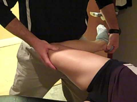 Dr. Duke Treating the IT Band using Graston and Active Release Techniques.
