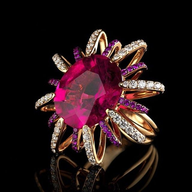 Absolutely breathtaking ring adorned with gorgeous rubelllite of flamboyant colour, sapphires and diamonds