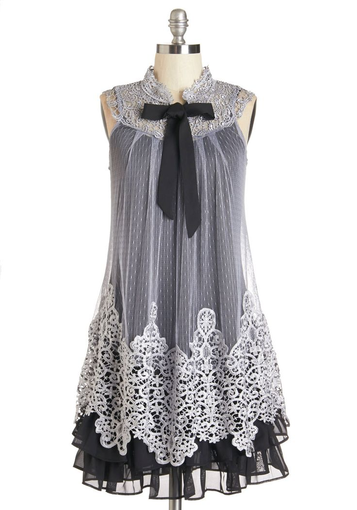 Expression of Elegance Dress. Tonight, you exhibit your enthusiasm for a gala date by wearing this layered shift dress from Ryu!You walk toward your sweetheart as your tie-neck frocks black, ruffle-trimmed lining swings around your legs, peeking out from a delicate lace overlay thats enhanced by swirling embroidery at the neckline and hem. #modcloth