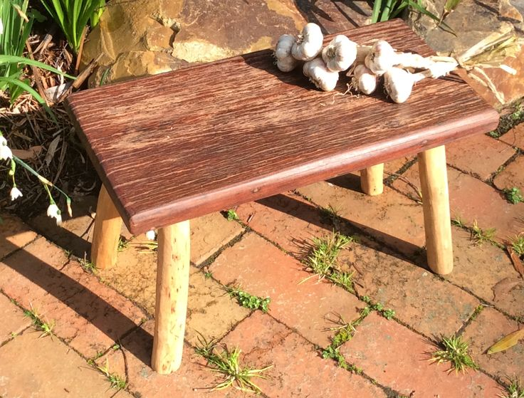 Latest Step Stool by Graeme Henchel. Recycled Redgum and Eucalypt legs. Strong enough to sit or stand on.