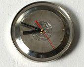 Upcycled kettle-bottom clock.