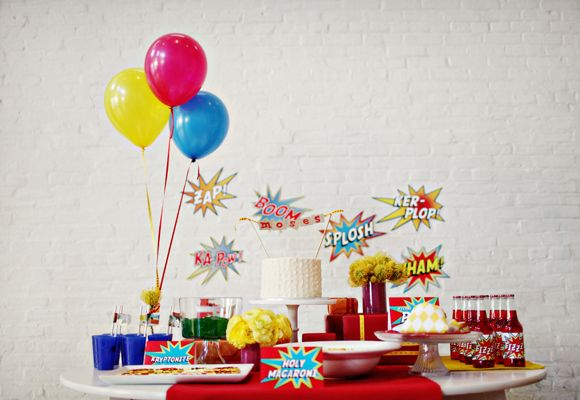 Turn your cake table into an IRL comic. | How To Throw The Most Awesome Superhero Party Ever