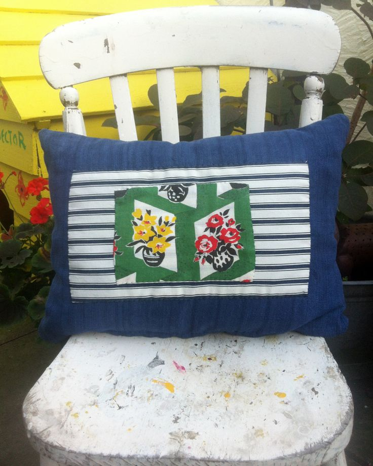 Vintage Cushion, Blue Linen with blue and white stripe ticking and green floral applique. Handmade item Materials: Linen, Vintage Floral, Floral, Vintage ticking, Vintage Stripe Cotton, Floral Pattern, Floral Material, Blue Linen Fabric, Floral Cotton, Linen Tablecloth, Green Floral fabric, Vintage Linen Ships from United Kingdom.  https://www.etsy.com/uk/listing/205151476/vintage-cushion-blue-linen-with-blue-and?ref=listing-shop-header-3