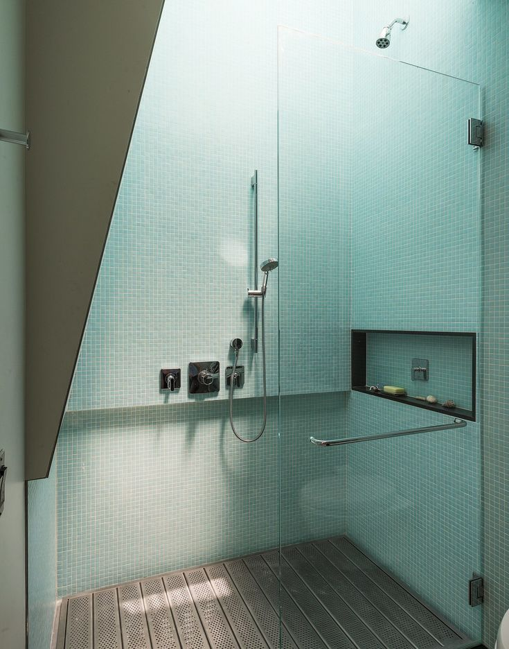 Architect Philippe Baumann, shower with perforated, galvanized-steel platform floor,aqua green mosaic tiles.