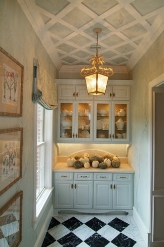 A nice little pantry nook. I don't usually like gold lights but this one works rather well.