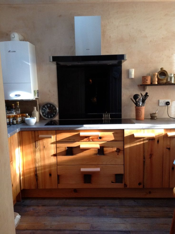 43) The new addition of a black glass splashback blends in really nicely with the black faced oven and hob