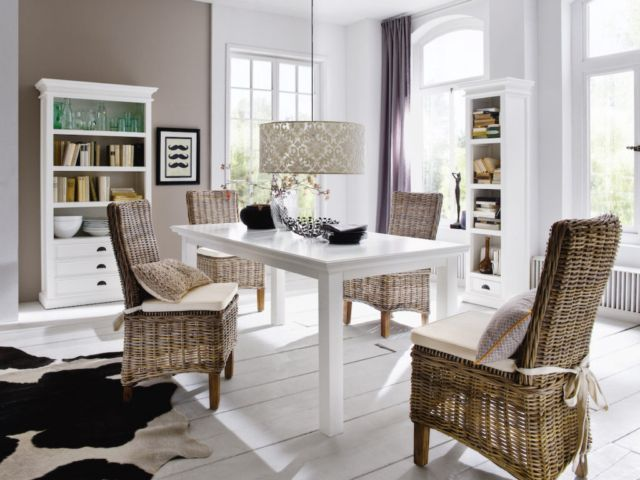 A casual yet chic dining chair realized in hand woven rattan encasing a solid mahogany curved frame. The dark natural tones contrast elegantly with the included seat cushion. Tie backs smartly keep the cushion in place but simultaneously add detail. Cleaning is a snap with the removable 100 % cotton cover, fabricated in a sturdy herringbone. Sold in pairs.