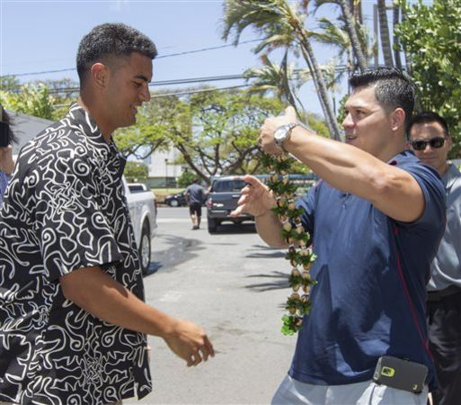 NFL Draft 2015: Former Oregon quarterback Marcus Mariota, left, is greeted by his friend Matt Wright, right, after arriving at the Saint Louis Alumni Clubhouse on NFL Draft Day Thursday, April 30, 2015, in Honolulu. (AP Photo/Eugene Tanner)