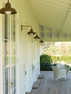 Pretty perfect verandah - wood deck, white ceiling with exposed beams, french doors and industrial-ish lighting