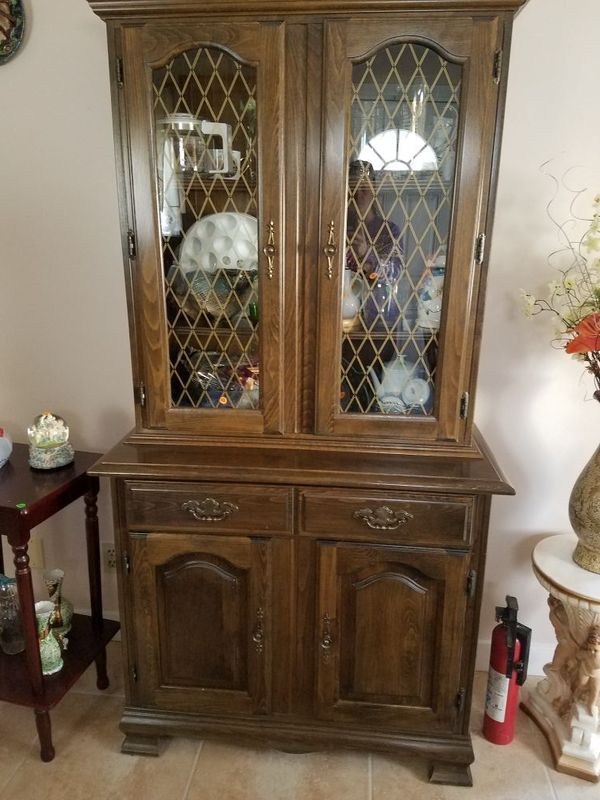 Used (normal wear) - Dark wood dinning room set 4 chairs table and china hutch. Best offer