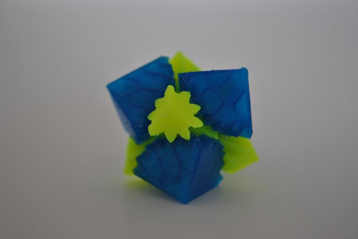cube gears by emmett customized .stl file: http://www.thingiverse.com/thing:50716 #3dprinted with translucent blue and neon yellow PLA by parametric | art http://parametric-art.com