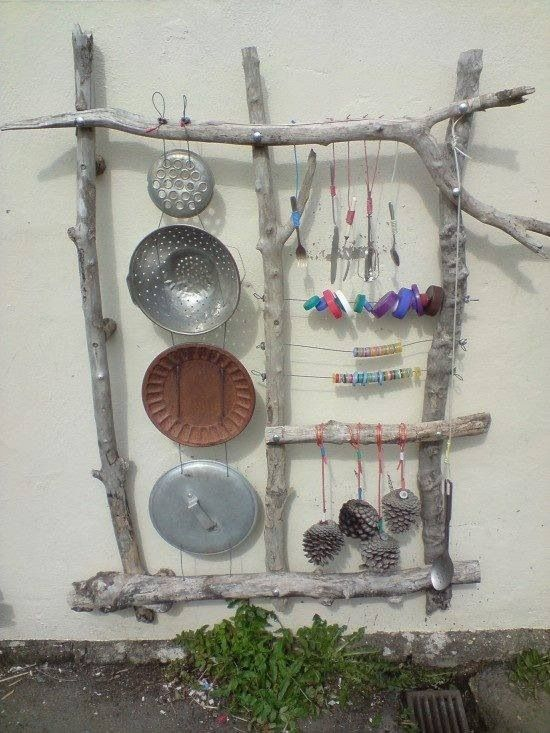 Old kitchen utensils up cycled into a music station for kids.