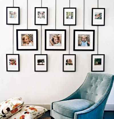 Photo display system is easy to change, without putting holes in wall.  Decorated by Anne Turner Carroll and Katherine Cobbs.  Photo by Jason Bernhaut for Cottage Living.