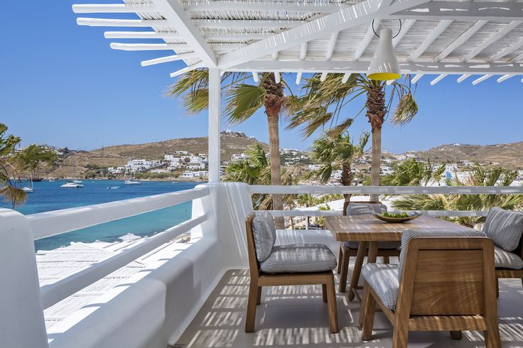 Enjoy the amazing views from the veranda of your Mykonos Blanc Hotel suite. Feel the cool summer breeze brush between your hair while sipping on your favourite beverage. Amazing! #MykonosBlanc #Mykonos #OrnosBeach #HotelInMykonos #MykonosHotel #Ornos #MykonosBlancHotel #Cyclades #Greece #Summer #LuxuryHotel