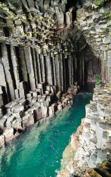 """Fingal's cave, or the Cave of Melody is a sea cave on the uninhabited island of Staffa. The beautiful geometric columns that make up the walls were formed by lava, and the echoes of the waves create an eerie melody when they bounce off the arched roof."""
