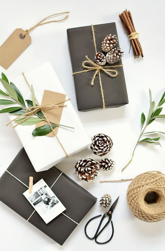 simple black or white wrapping paper looks amazing with twine, snowy pinecones and foliage