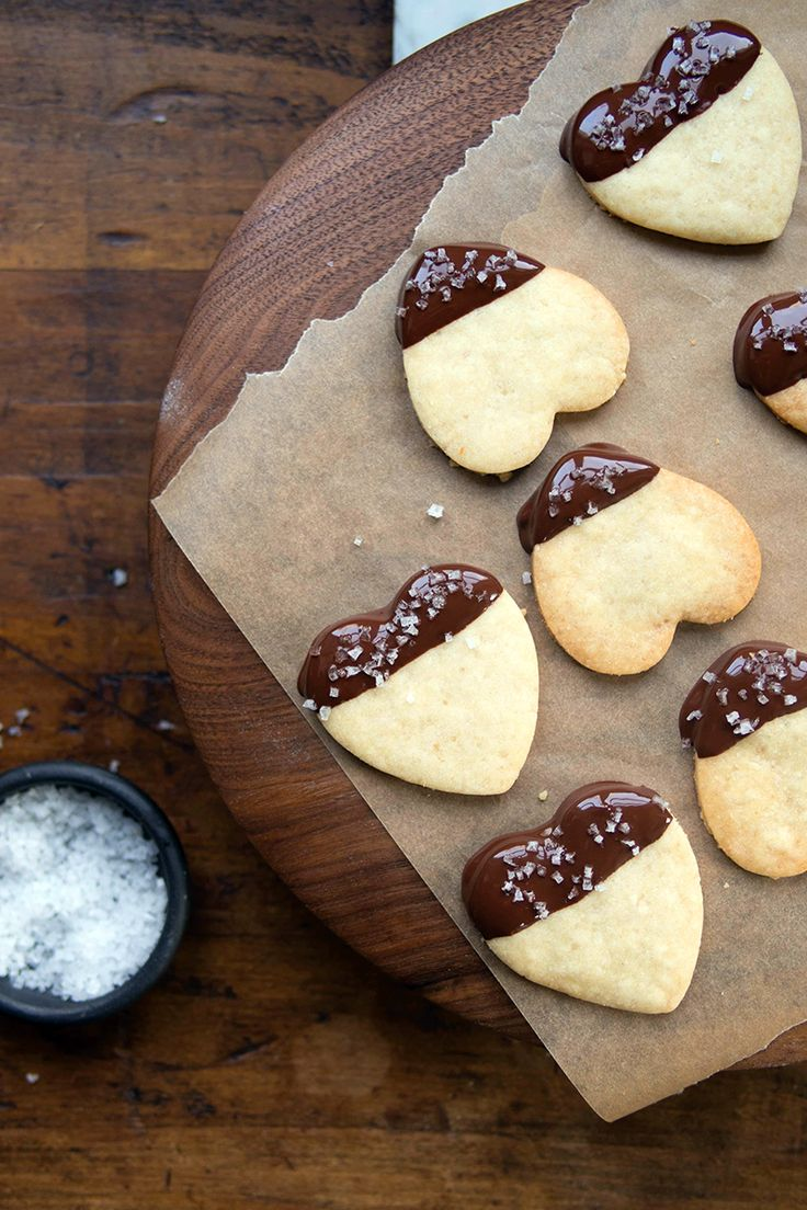 Made using a simple shortbread recipe, the buttery dough in these chocolate-dipped shortbread cookies is rolled out and cut into hearts (or whatever shape you like).