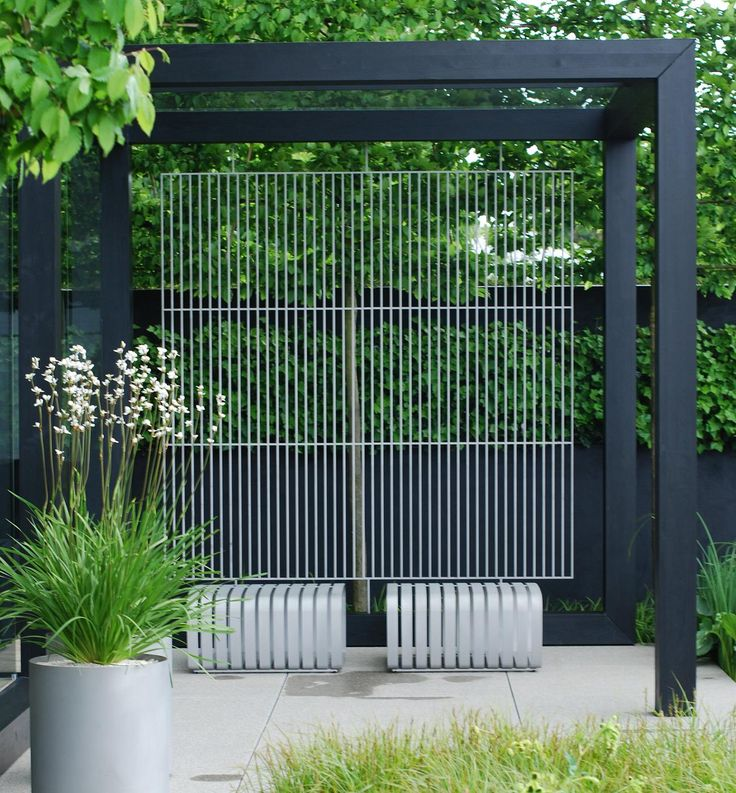 We will have a dark grey pergola similar to this, built in Top Garden, near to…