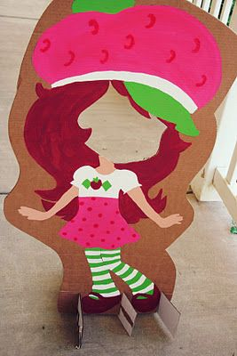 Strawberry shortcake cutouts for kids parties!  Go to a home depot and ask for their cardboard boxes (fridges). paint a character or characters for the girls to put their face in