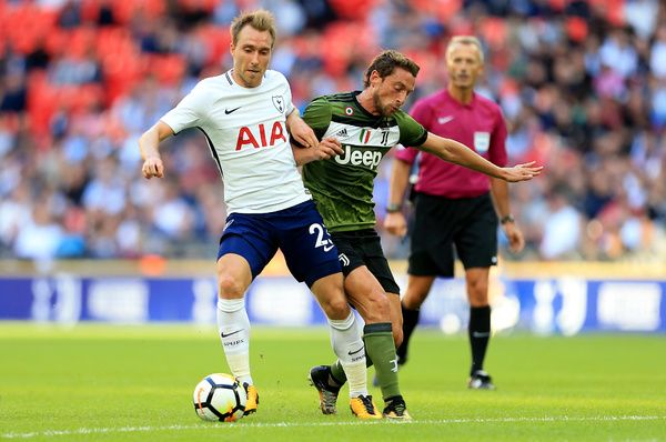LONDON, ENGLAND - AUGUST 05: Christian Eriksen of Tottenham Hotspur competes with Claudio Marchisio of Juventus during the Pre-Season Friendly match between Tottenham Hotspur and Juventus on August 5, 2017 in London, England