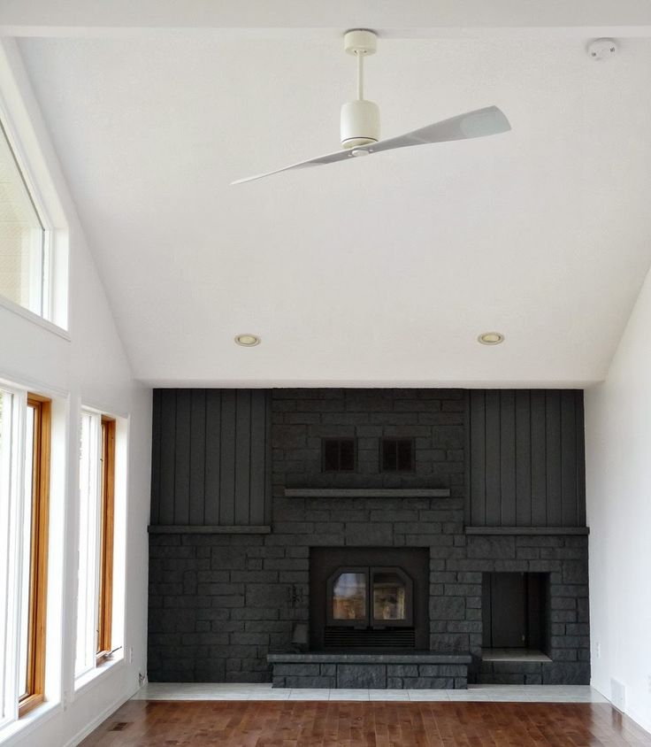 LOVE this black brick fireplace wall!
