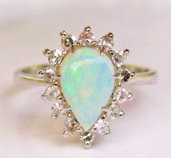 I love this pear shaped opal and diamond ring with its soft pastel coloring and shape that looks beautifully feminine on the hand! The opal