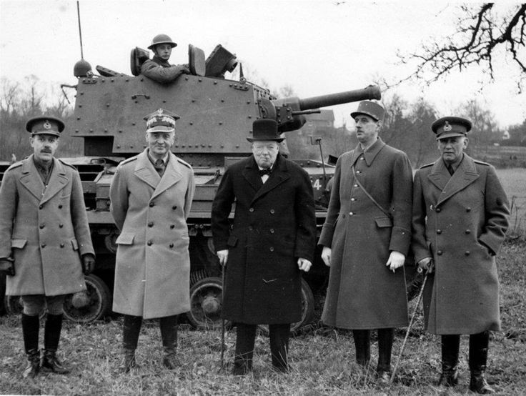 Churchill with General Wladyslaw Sikorski, Prime Minister of the Polish Government-in-Exile and Commander-in-Chief of the Polish Armed Forces and General Charles de Gaulle, General Officer Commanding French Forces, following a tank demonstration on February 14, 1941