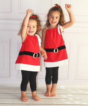 The jolly spirit of Santa is perfectly conveyed in this classic Santa Claus dress. Worn by itself or with a tee shirt and leggings, it'll be sure to bring some adorable holiday spirit to the next gathering or family photo.
