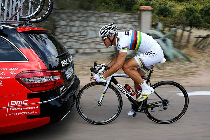 Phillipe Gilbert pictured during a training session prior to the first stage of the Tour de France. You can barely fit a cigarette paper between his front wheel and the BMC team car he's drafting.Photograph: YOAN VALAT/EPA
