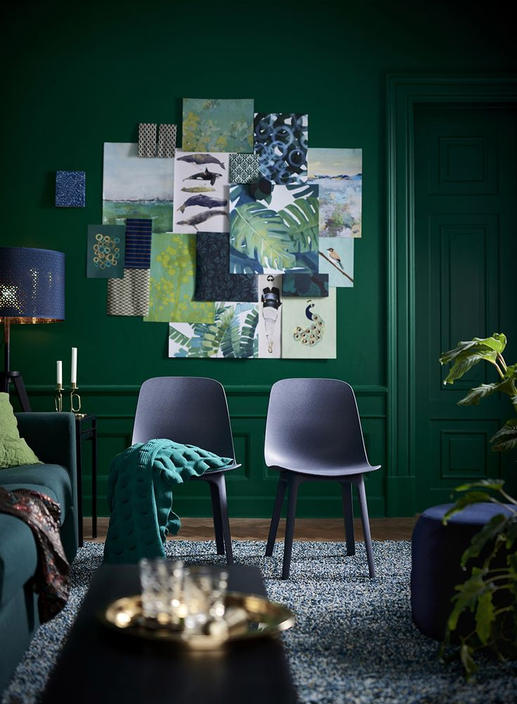 Green painted wall, blue chairs from Ikea. Ideas how to decorate with the biggest trends 2018.