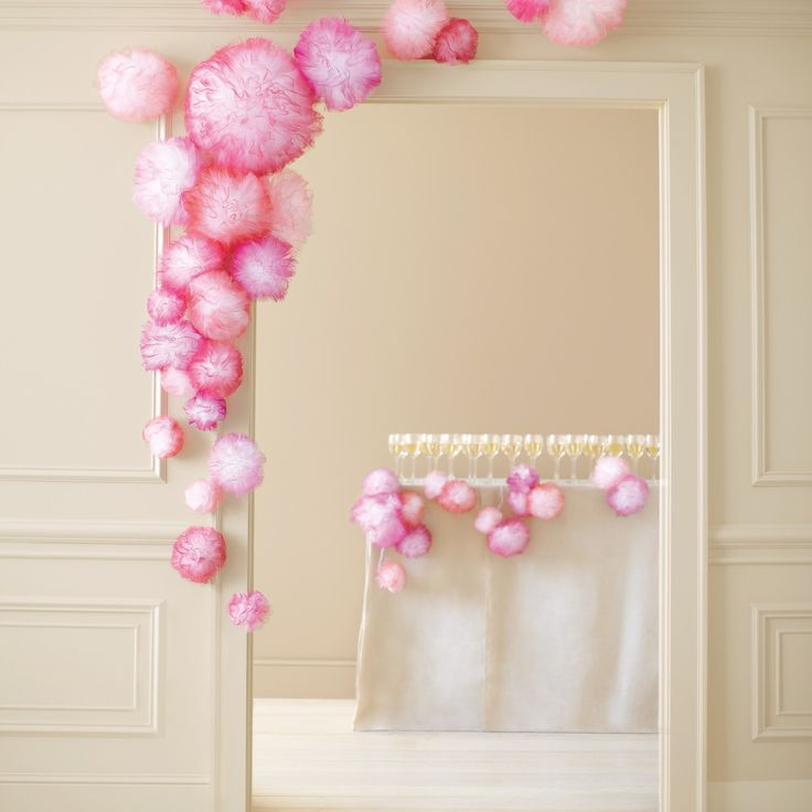 Festive pom-poms add cheer to any event space. Simply fashion inexpensive white tulle into different-size poufs, and mist with spray paint in your favorite color. String your handiwork up garland-style, or tape it around a door, bar, or escort-card table.