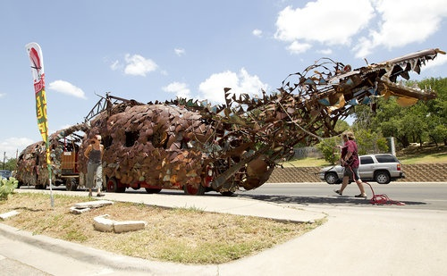 An 80-feet-long rusty dragon art car wound its way through Austin last week toward its ultimate destination at a ranch on Fitzhugh Road. Click through to see more photos and read about how the dragon car came to be. Photo: Alberto Martinez/American-Statesman