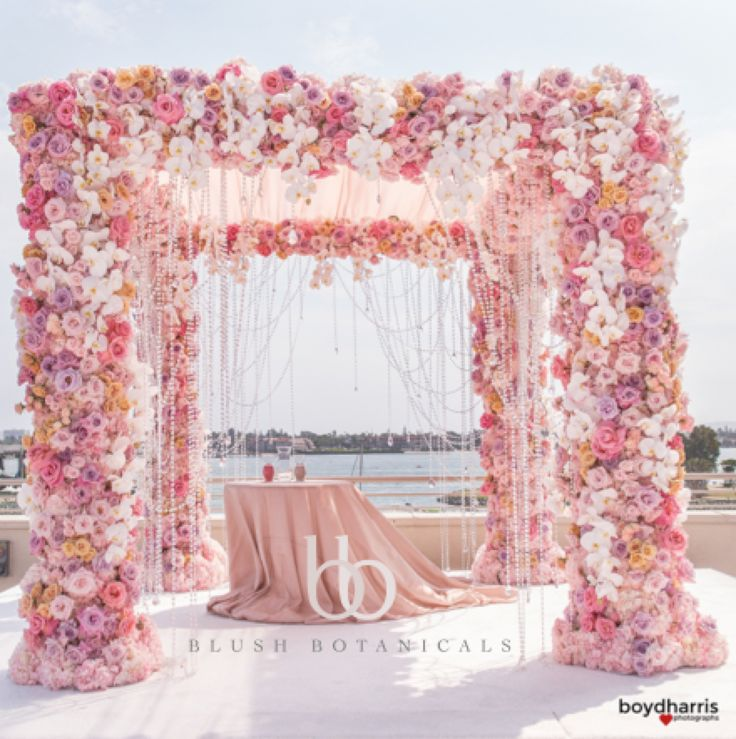 WAGS Miami star marries Corey Liuget of the Chargers in this glamorous pink and pastel San Diego wedding by Blush Botanicals, Details Defined, Hire Elegance.  Pink Wedding, over the top wedding, flower chandelier, chuppah, flower canopy.  flower canopy, flower chuppah  photo: Boyd Harris