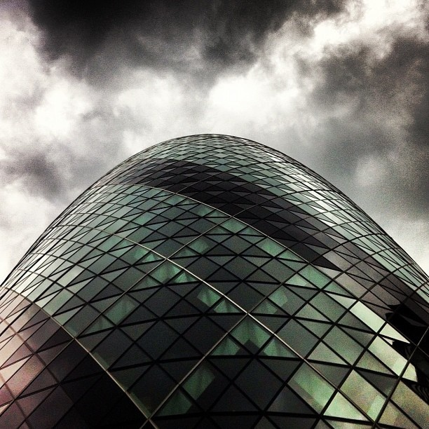 #london #gherkin #architecture #lookingup #sky #reflection #glass #building #clouds by Jessica E Squires, via Flickr