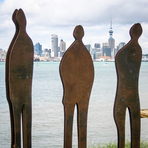 Shock & Awe: three corten steel figures on the edge of Auckland Harbour - CBD is in the background. Each figure is approximately 2m tall. Private collection.