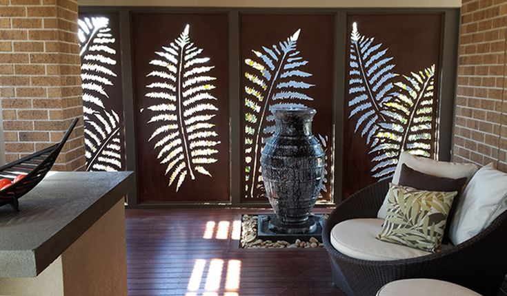QAQ 'Fern Leaf' decorative screen panels in compressed hardwood make this patio area look divine and luxurious.